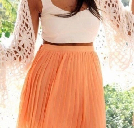 GIrl wearing crop top and skirt