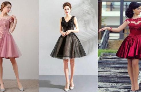 three girls wearing prom dresses