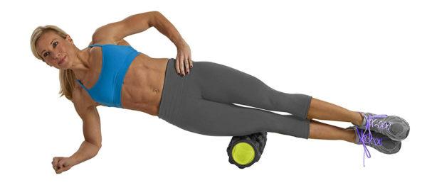 woman using Gofit Extreme Massage Roller