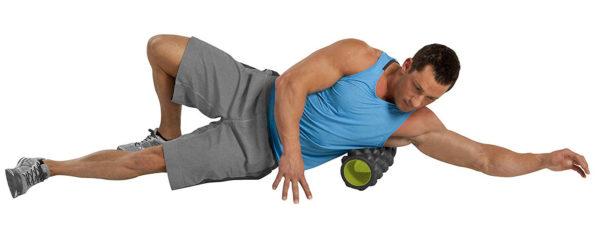 man using Gofit Extreme Massage Roller