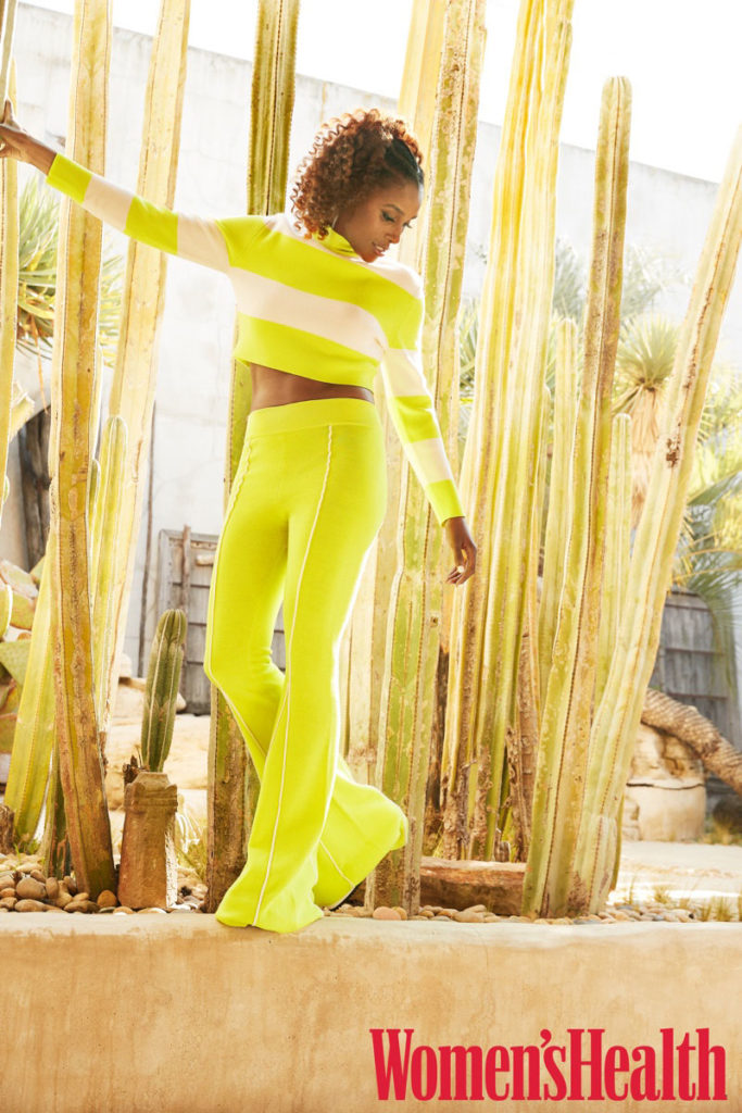 Issa Rae poses in Victor Glemaud sweater and pants