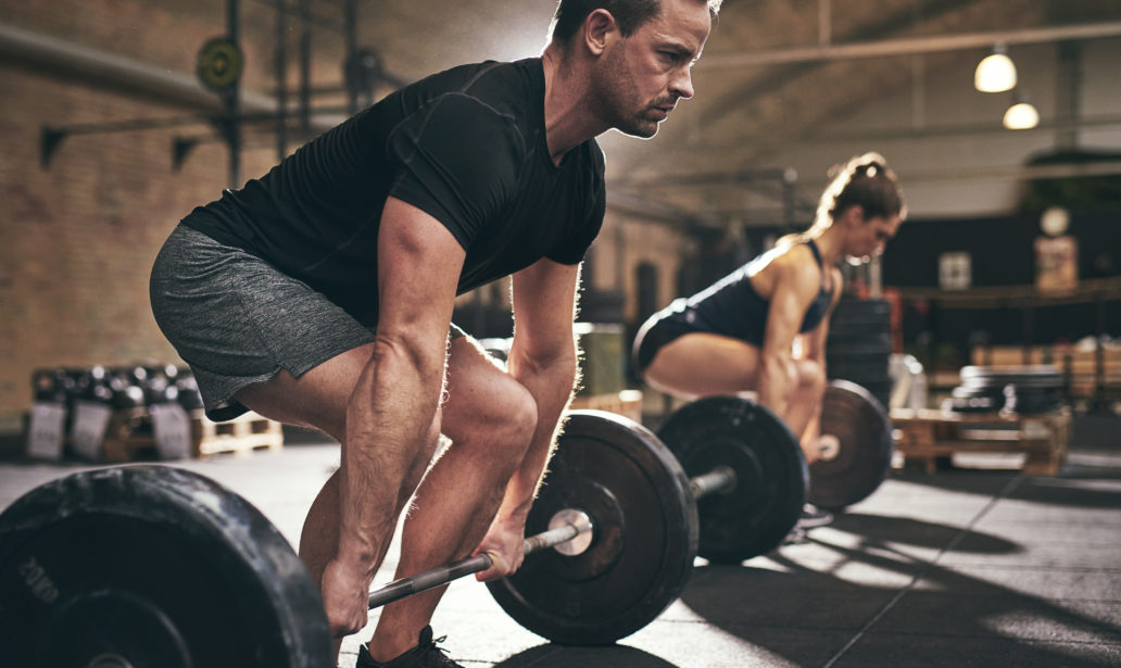 Sporty Man Woman About Lift Barbells Stock Photo