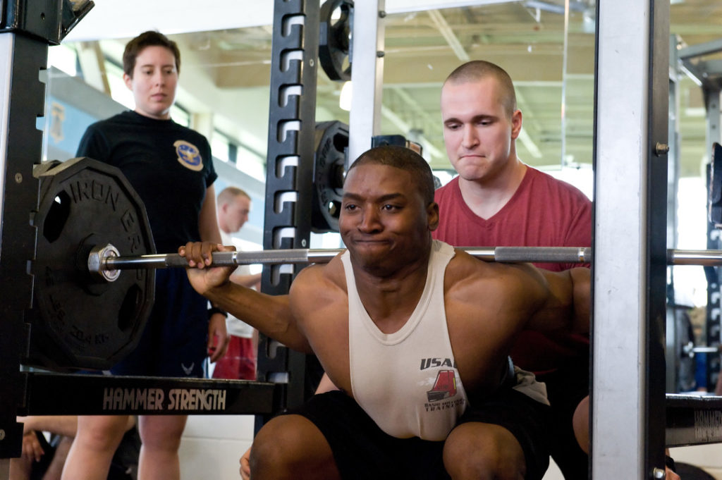 Tavin Alford successfully squats 350 pounds on his first of three attempts in the squat during the powerlifting competition May 8, 2015, at the Fitness Center on Dover Air Force Base, Del.