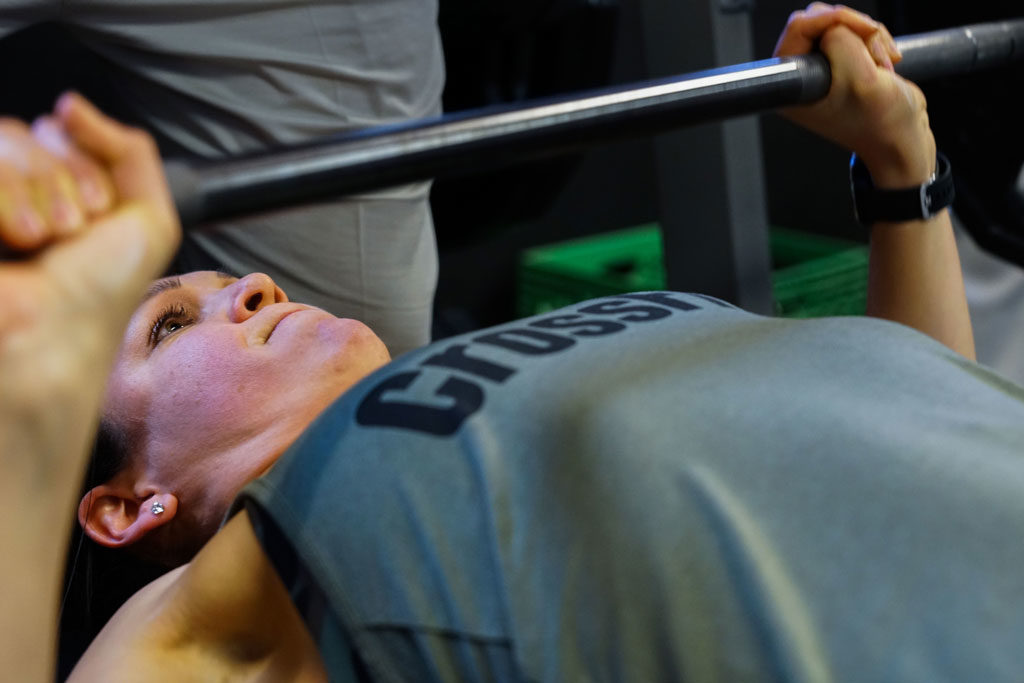 Ana Shockey, 50th Security Forces Squadron, bench presses 135 pounds during the annual Bench Press and Deadlift competition at Schriever Air Force Base, Colorado, Jan. 26, 2018.