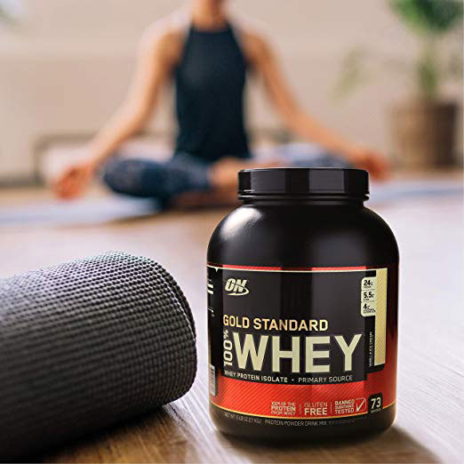 woman meditating with Optimum Nutrition Standard Whey Protein Powder