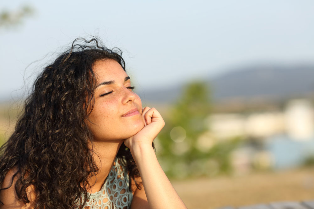Woman Relaxing Enjoying Sun Warmth Park Stock Photo