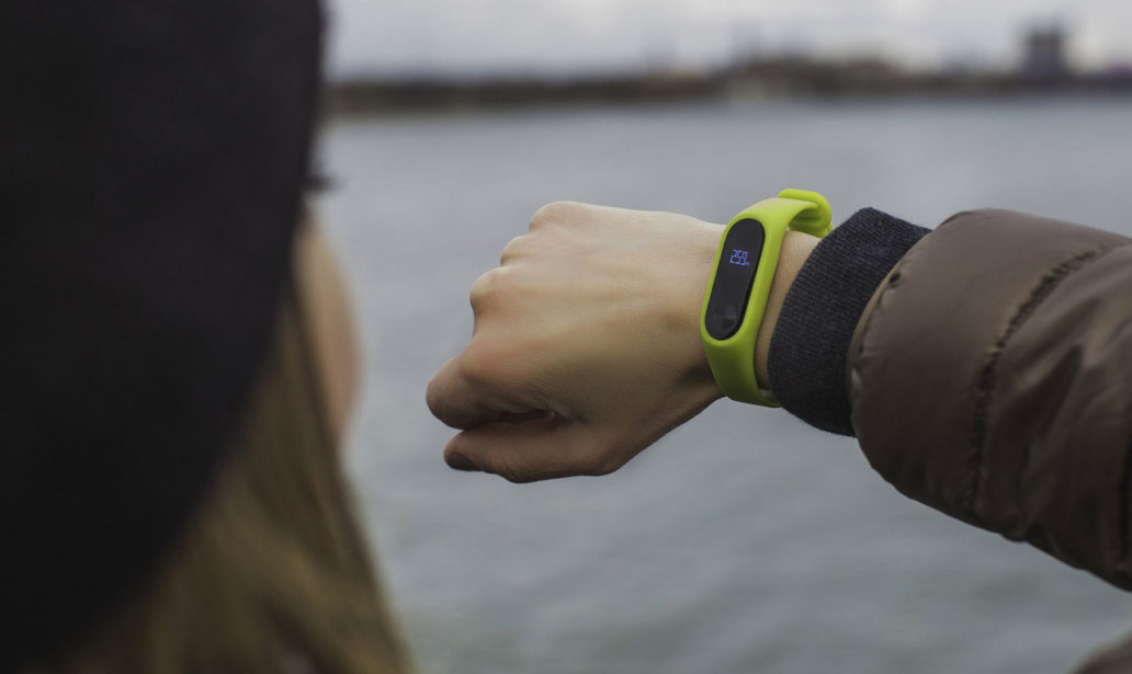 Girl looking at fitness tracker