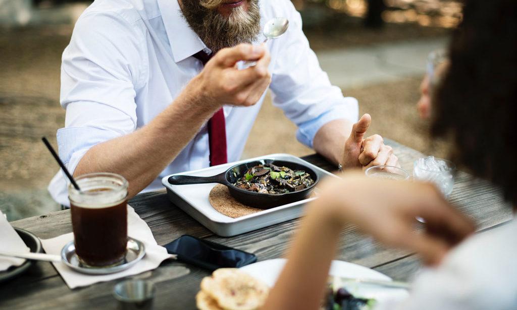Man Eating Food at Table