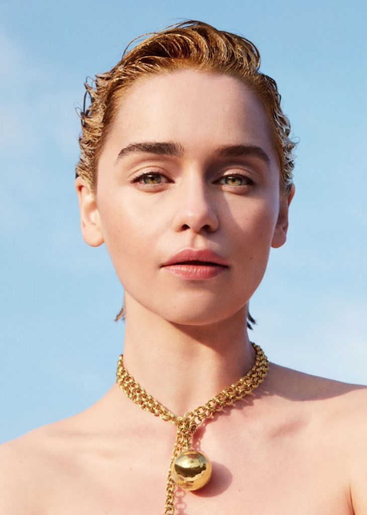 Shining in gold, Emilia Clarke wears Bottega Veneta necklace