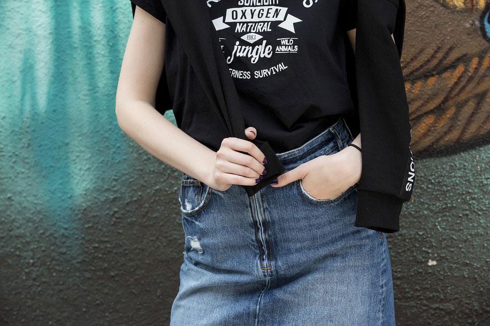 girl wearing black t-shirt and logos