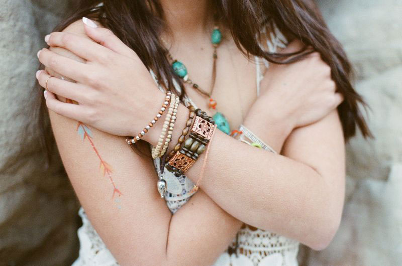 girl wearing bracelets and necklaces