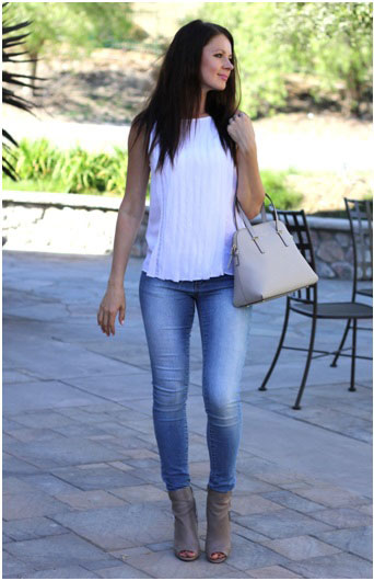 girl wearing a white top and blue jeans