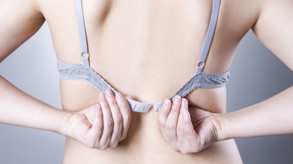 girl wearing a bra that does not fit