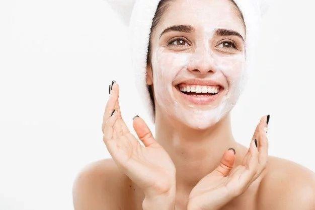 girl exfoliating her skin