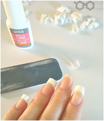 gluing on acrylic nails