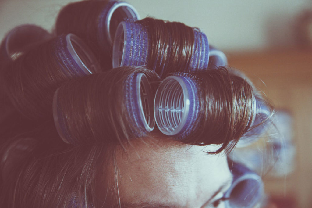 girl with rollers in her hair