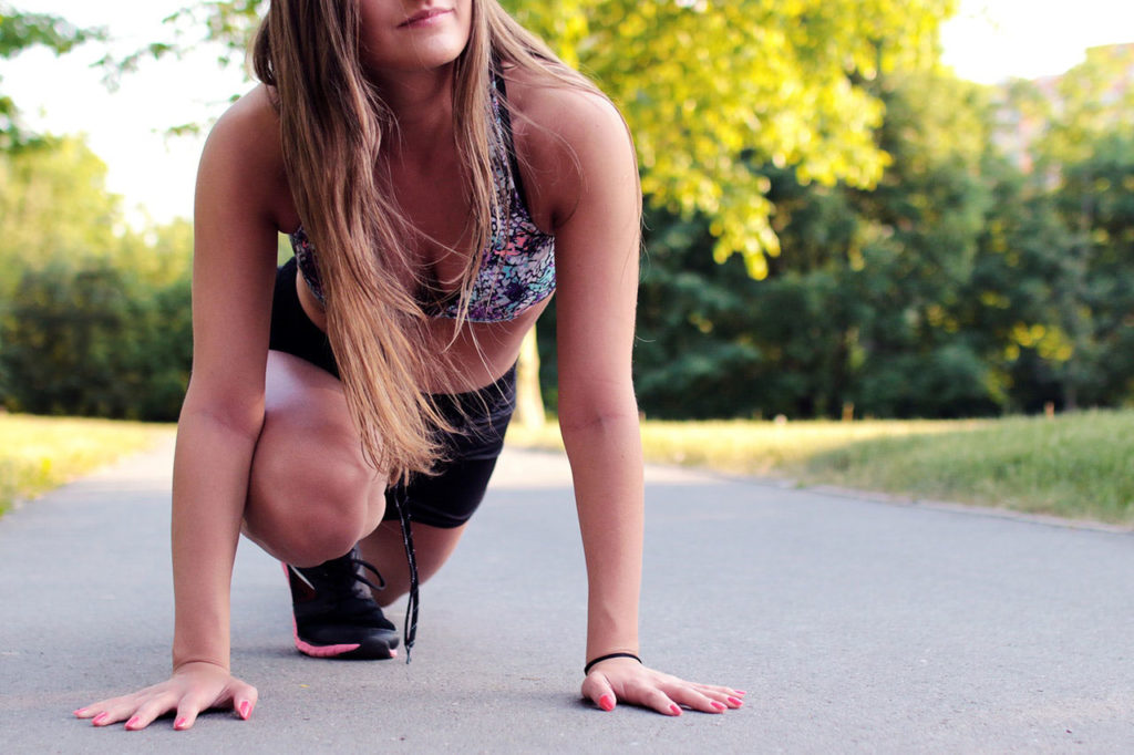 girl in sports bra doing a lunge