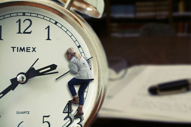 woman climbing a Timex clock