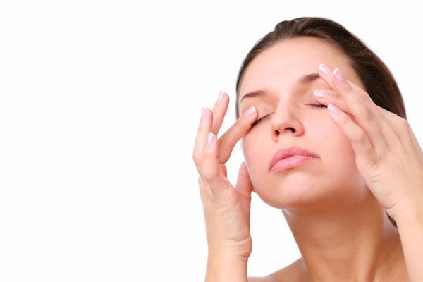 girl massaging her eyelids