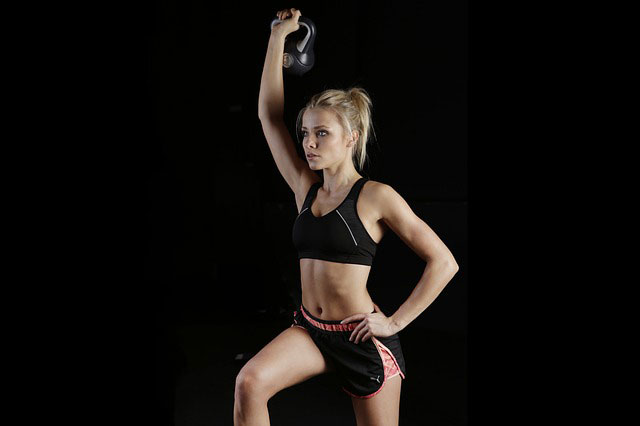 girl doing kettlebell exercise