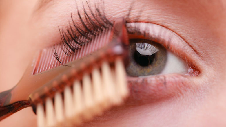 separating eye lashes with brush