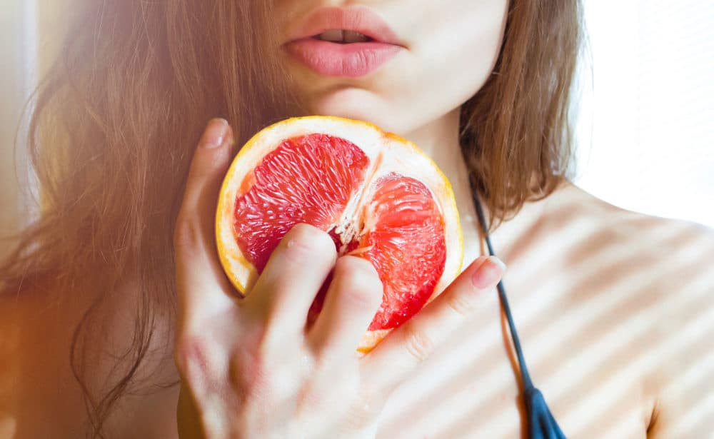 Beautiful Young Sexy Woman Bikini Holding Grapefruit Stock Photo
