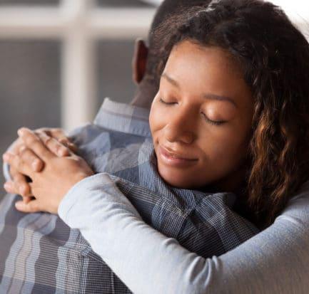Happy Mixed Race Woman Hug Black Stock Photo
