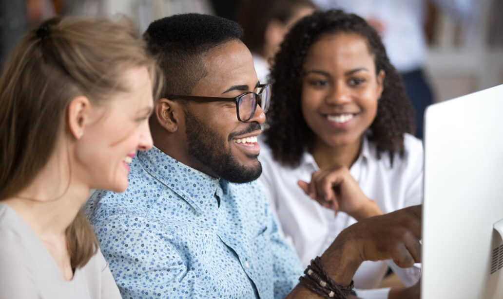 Smiling African Employee Team Leader Explaining stock images