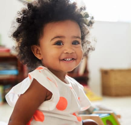 Happy Baby Girl Playing Toys Playroom Stock Photo