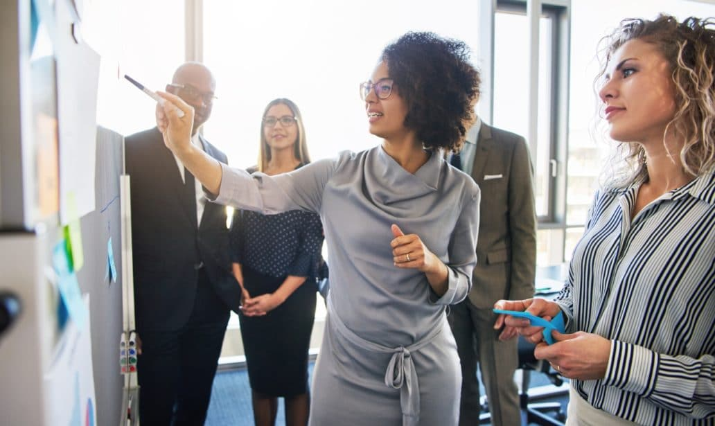 Diverse Group Focused Businesspeople Brainstorming Together Stock