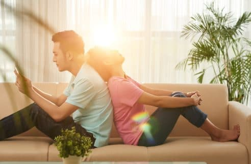Vietnamese Young Couple Doing Nothing Home
