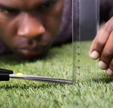 Closeup Man Cutting Green Grass Measured