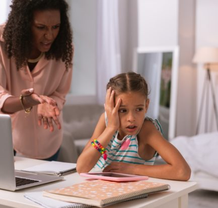 Bad student. Nice unhappy girl turning away from her mother while not wanting to listen to her