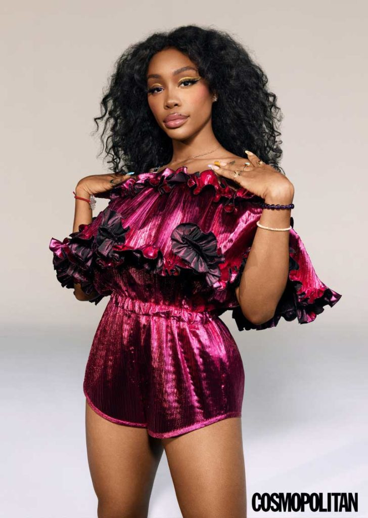 Flaunting some shoulder, SZA poses in Alexandre Vauthier jumpsuit.