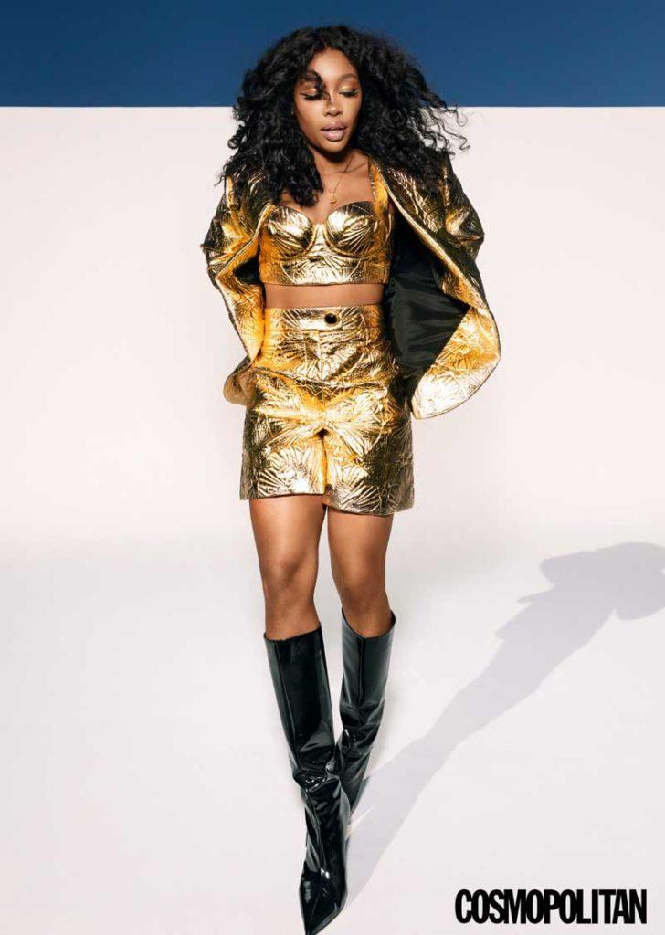 Shining in gold, SZA rocks Escada three-piece suit and Paris Texas boots.