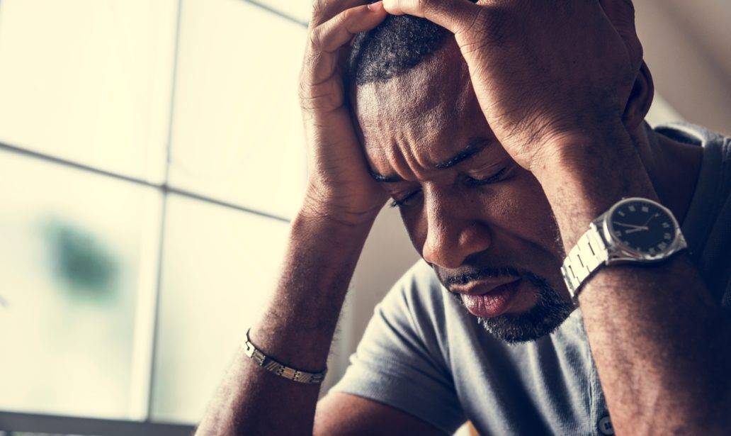 Black guy stressing and headache